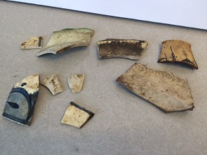Shards of pottery, found beneath the floors